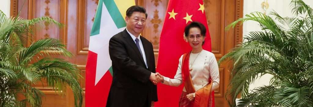 Chinese President Xi Jinping (L) and Myanmar State Counsellor Aung San Suu Kyi shake hands before a bilateral meeting at the Presidential Palace in Naypyidaw on January 18, 2020. (Photo by Nyein CHAN NAING / POOL / AFP)