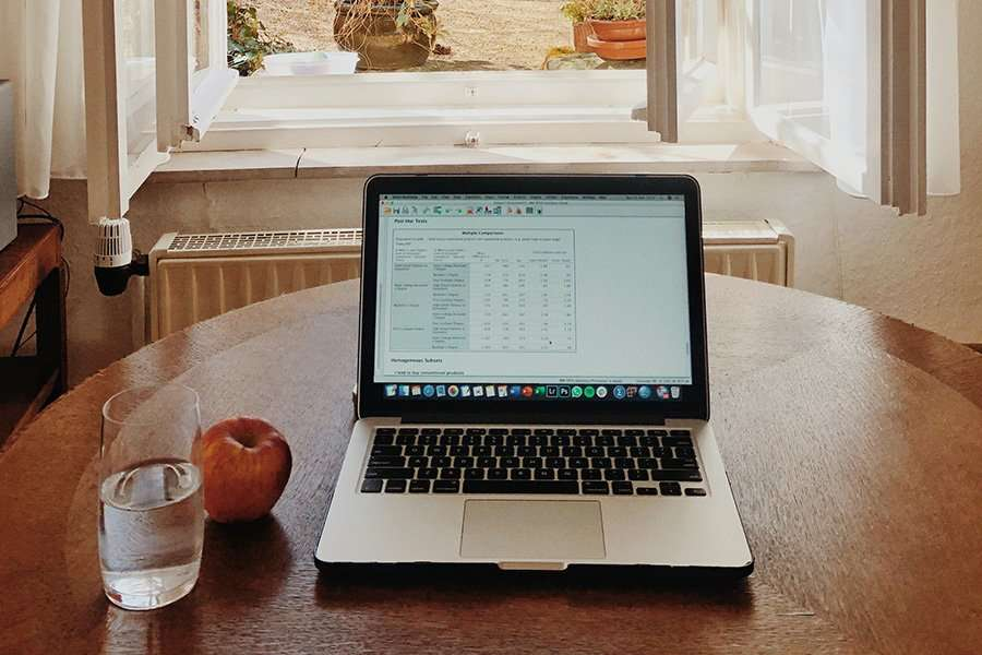 laptop on home table with snack